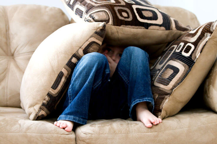 10 reasons why people avoid seeking financial help - Boy hiding under pillows