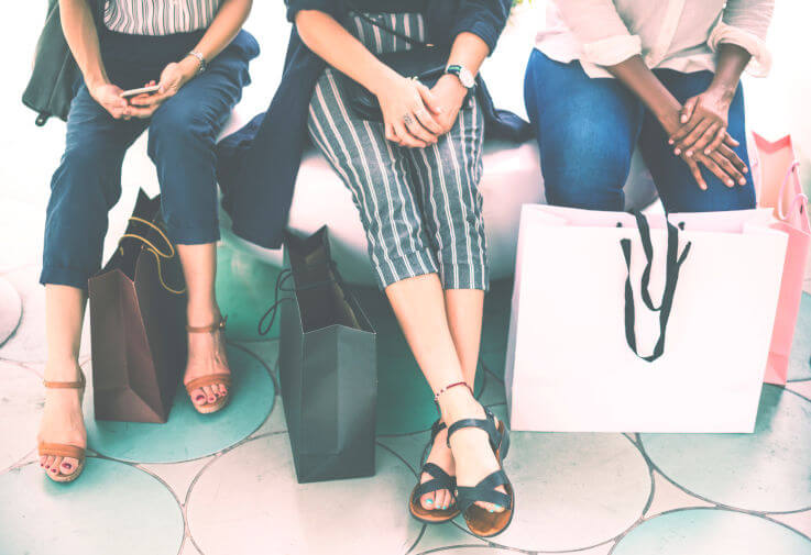 5 easy steps on reducing debt - Women with shopping bags