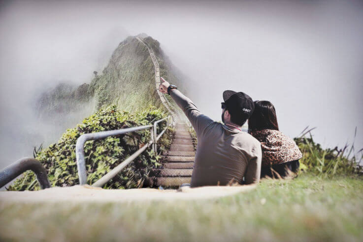 8 steps savings plan - Couple at the base of hike