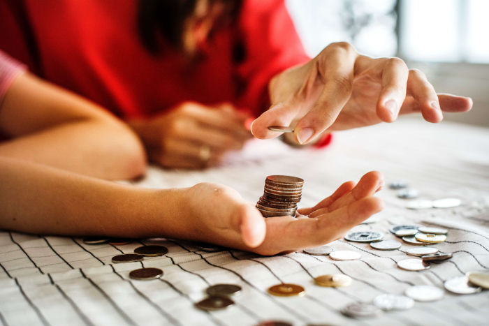 Debt Consolidation Solutions, Loans & Advice in Perth WA - Counting stack of coins