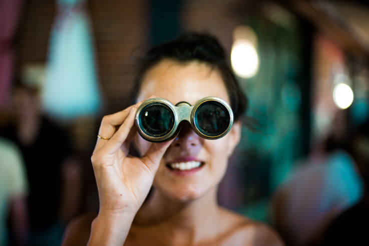 Bad credit find suitable personal loans - Woman looking through binoculars