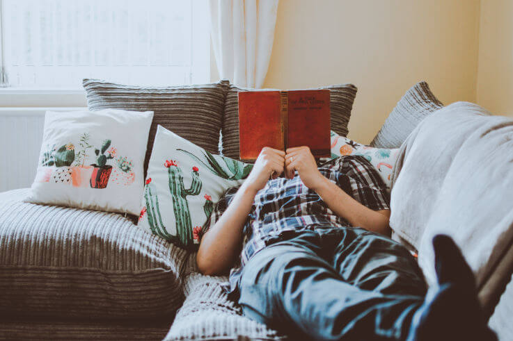 Can I consolidate debt into a home loan - man reading on sofa