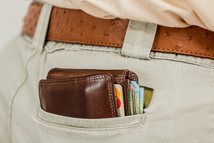 Debt consolidation or credit card whats the best choice - Wallet in pocket