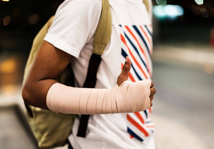 Debt help that does not hurt credit - Bandaged arm with thumbs up