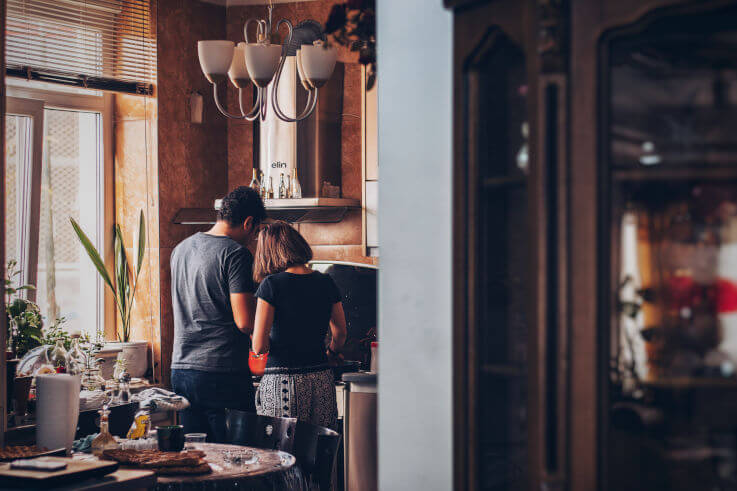 Debt help without losing house - Couple cooking at home