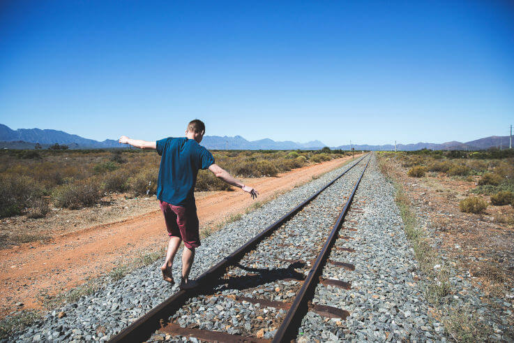 Debt relief solutions giving you financial stability - Balancing on train tracks