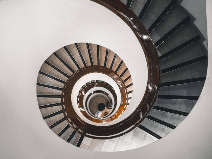Falling into a debt spiral here's how we help - Spiral stairs