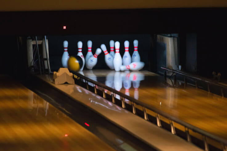 Get rid of multiple debts with debt consolidation loans - Bowling over pins