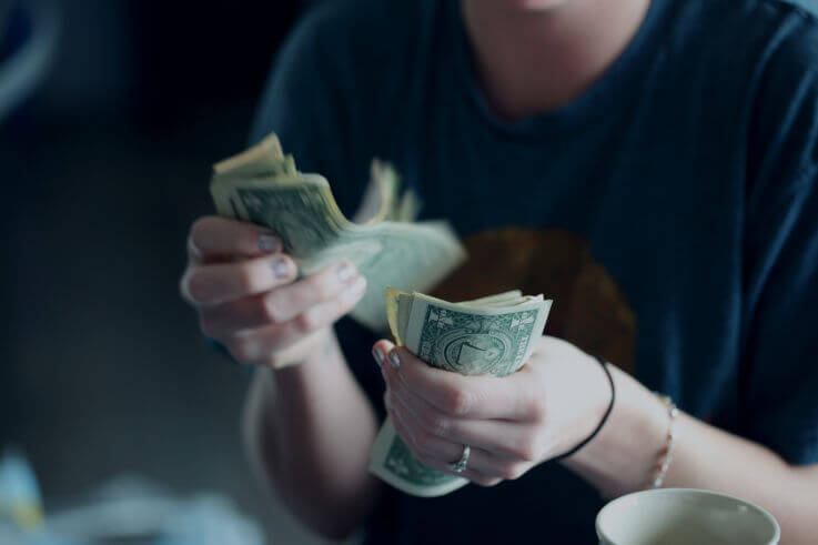 How to get debt relief - Woman counting money