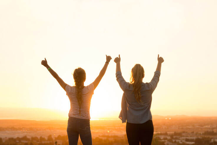 Long term solutions for debt relief in Australia - Thumbs up in the sunset