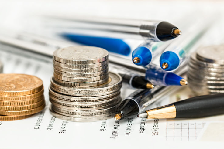 Solutions for bad credit - Coins and pens