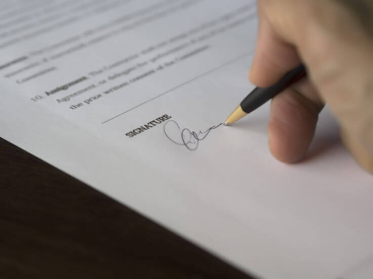 What you need to know about declaring bankruptcy - Signing document