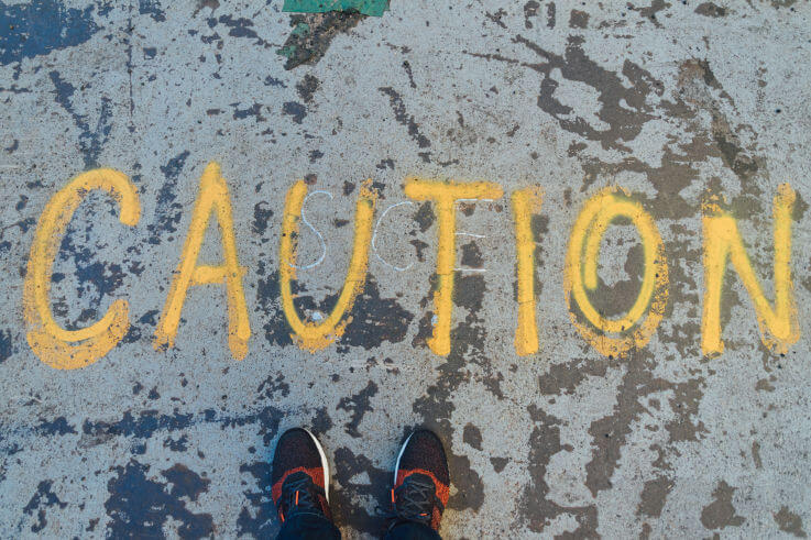 When is debt consolidation a bad idea - Caution written on ground