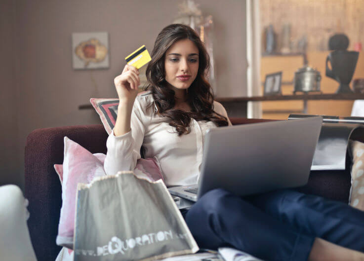 Why bad credit is bad for you - Woman making online purchase